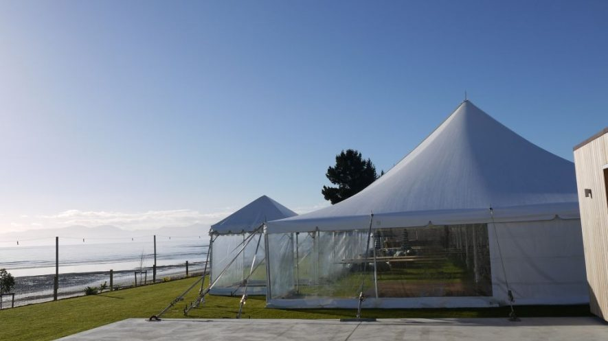 A big 12m x 30m Peg & Pole up for a wedding in a fabulous setting. A 10m x 15m can be seen at the far end also up for the ceremony.